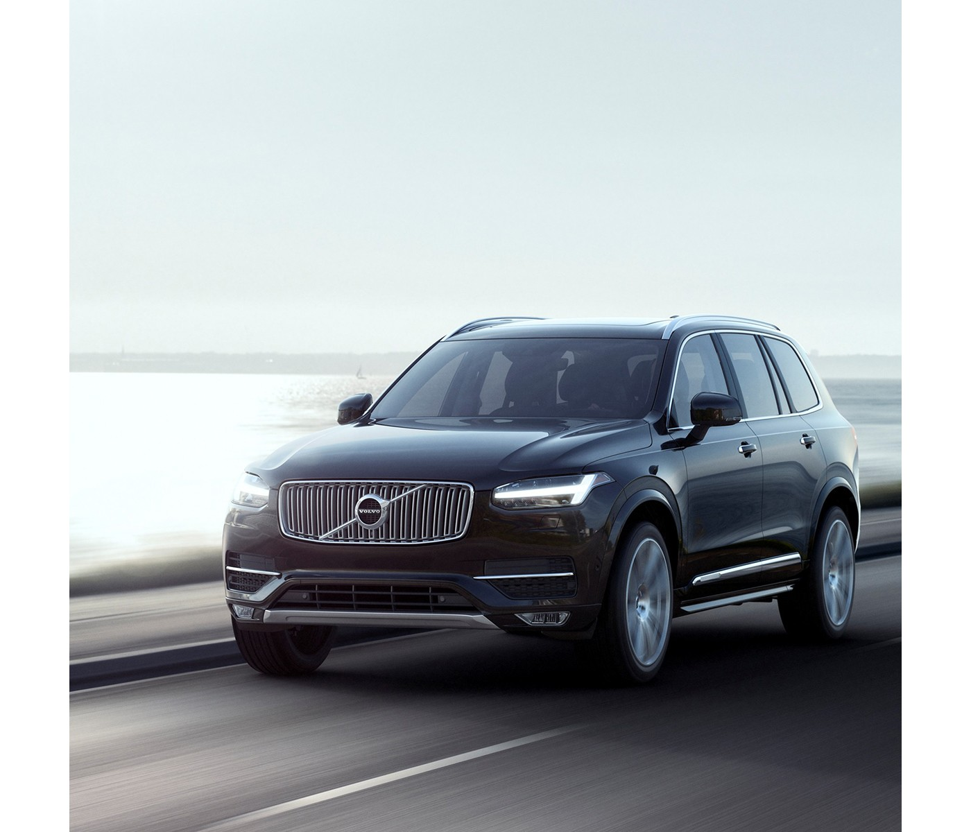Black Volvo XC 90 sport utility vehicle driving on the highway