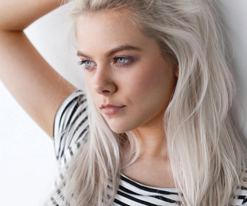Woman with blonde hair and dark roots