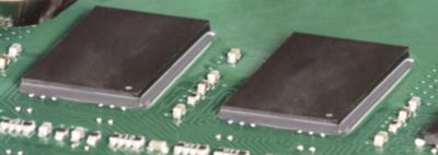 Photo of components on green pcb utilizing board level underfill material