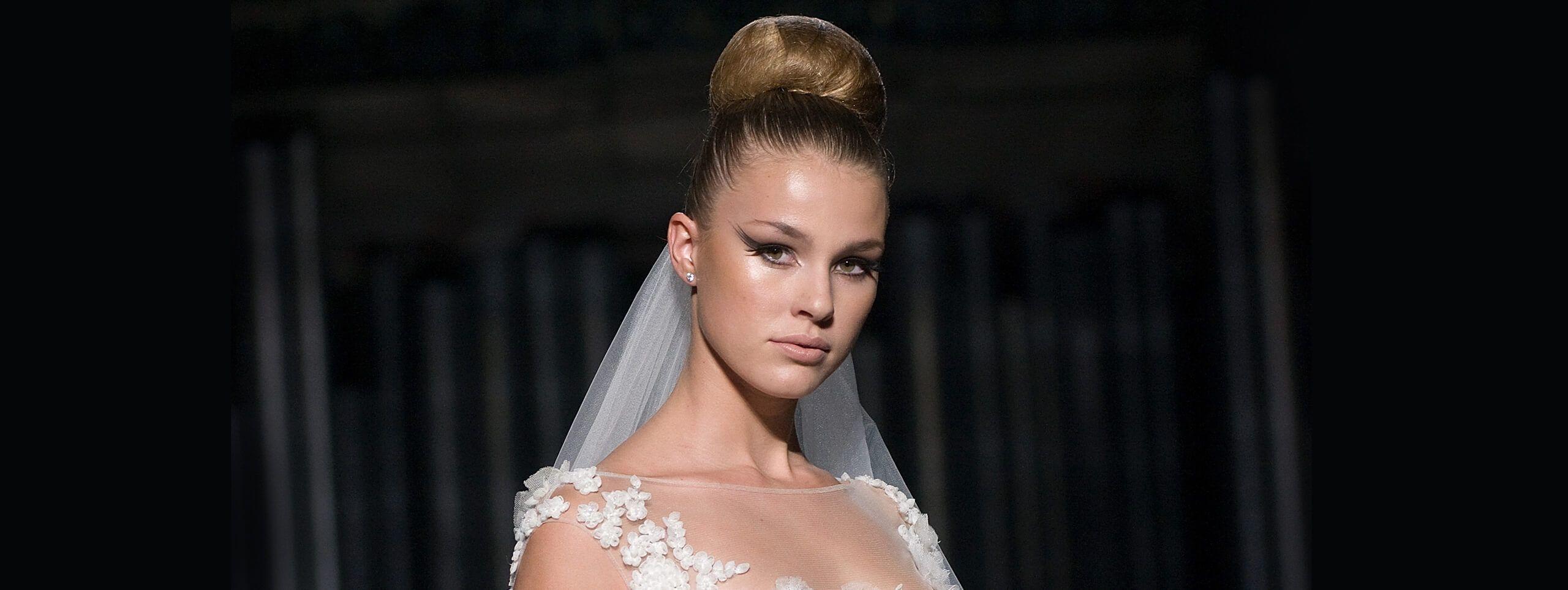 Bride wears hair in high bun updo hairstyle for wedding