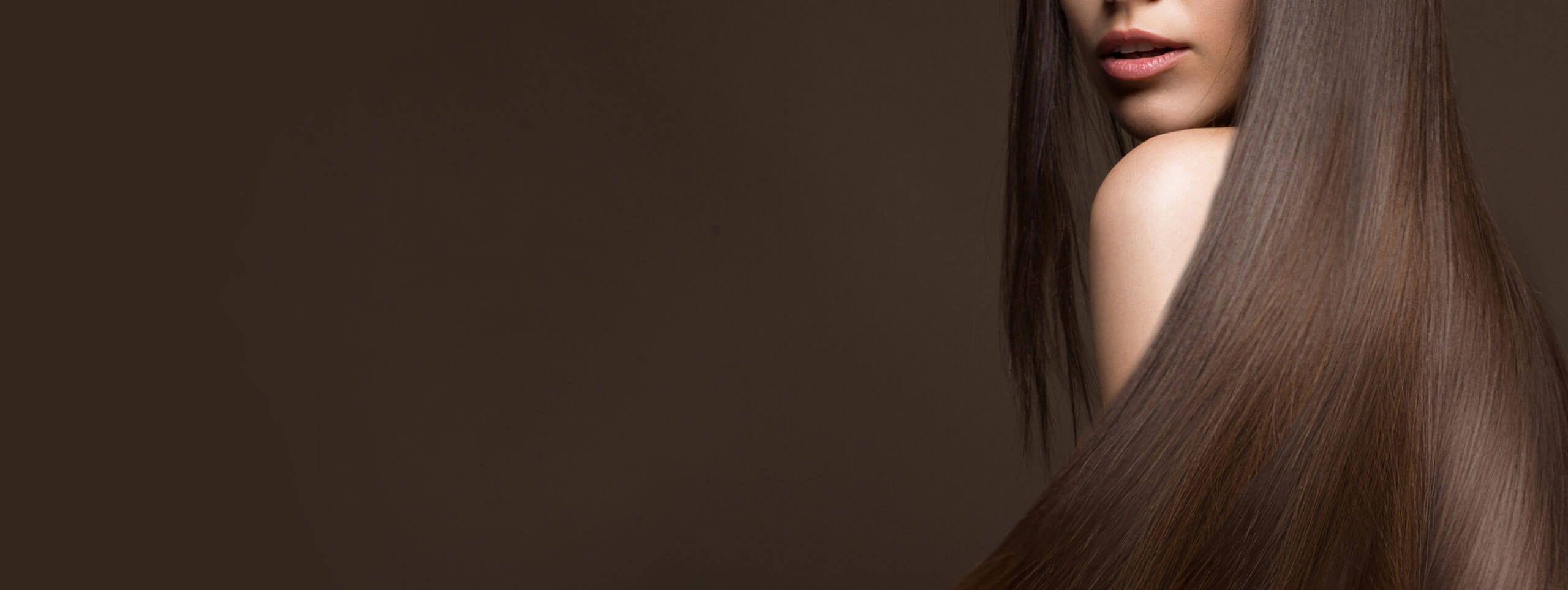 Brunette woman models long beautiful hair