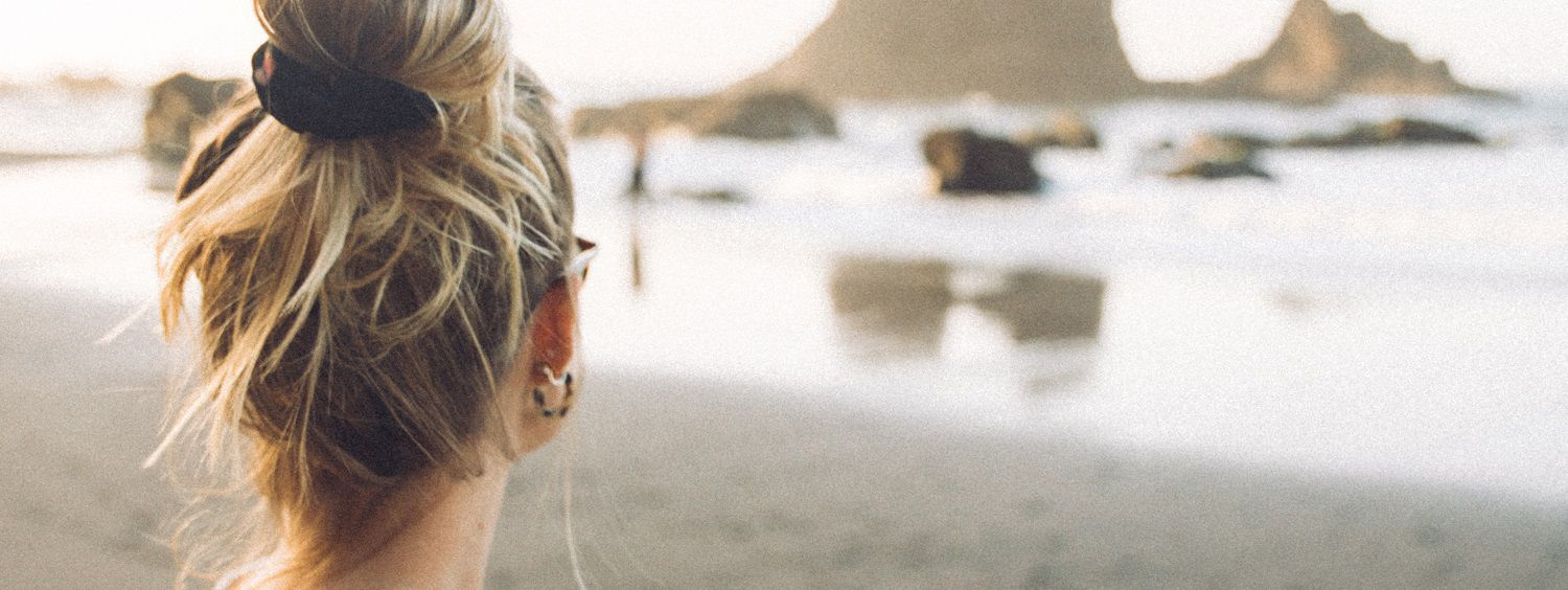 Woman on the beach with messy bun
