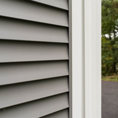 Caulking and sealing air and water leaks in vinyl siding
