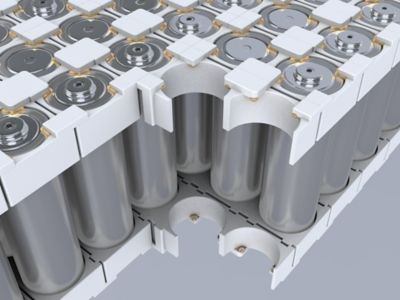3D image of a partial battery module with cylindrical cells, which are glued together in a plastic holder