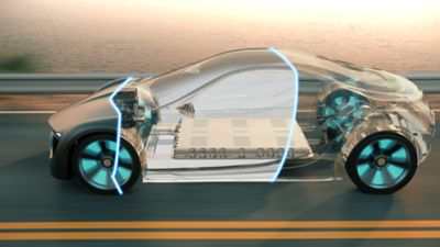 Closeup of electric vehicle with transparent cross-section driving next to the beach