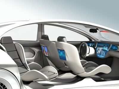 Closeup of a white concept car showing the insides of the vehicle with new, innovative technology