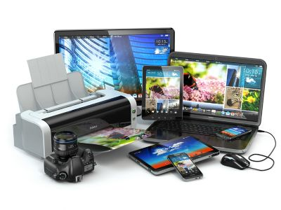 Photo of a variety of consumer electronic devices including printer,tablet,cell phone,camera,laptop,computer shutterstock ID 217080976