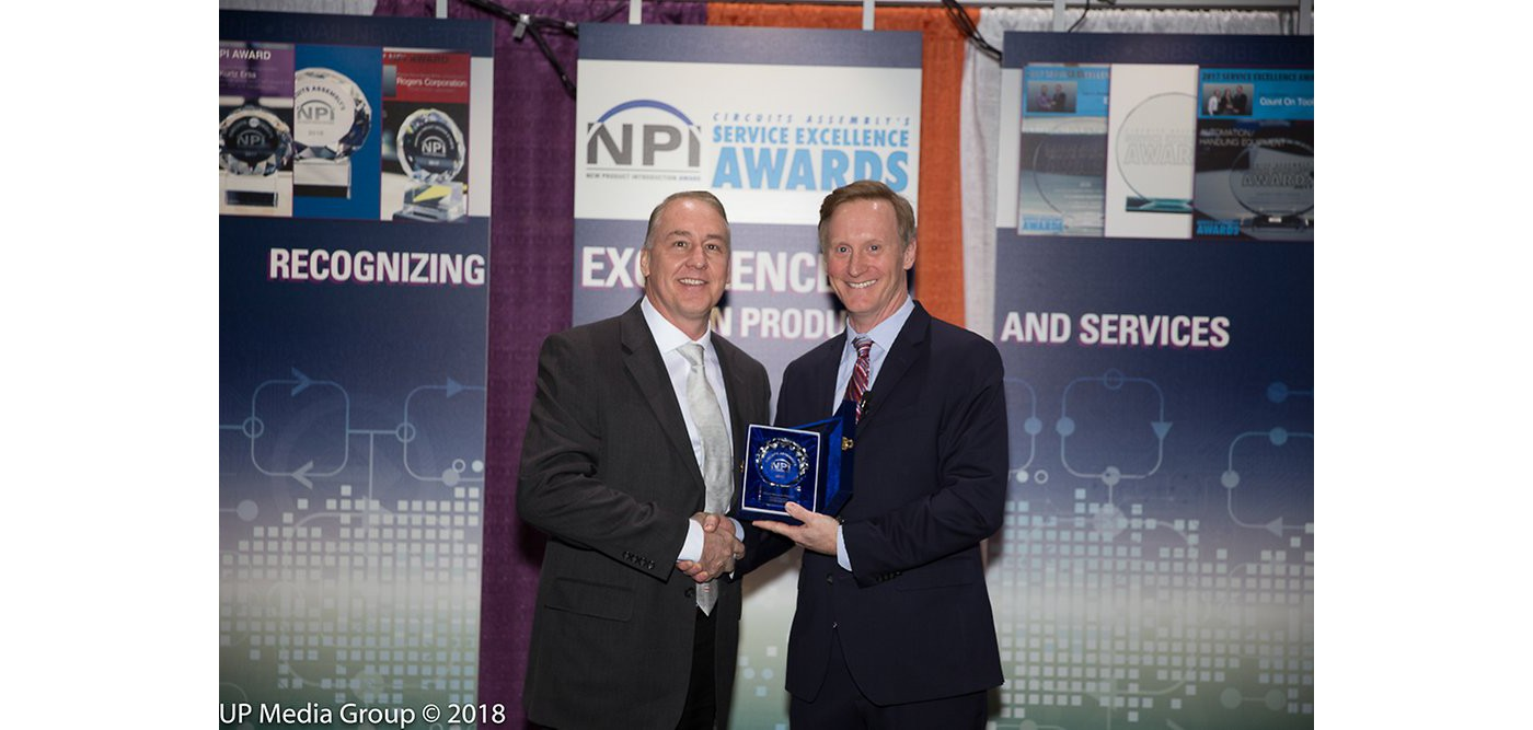 Photo of doug dixon accepting trophy in circuits assembly magazine's annual npi excellence award contest recognizing henkel adhesive electronics group for its broad innovation portfolio March 2018