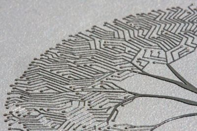 Photo of loctite 1006 a silver electrically conductive ink creating a tree pattern on a circuit board