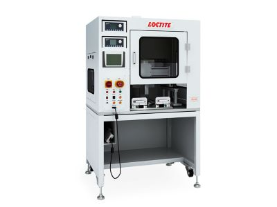 Photo of Henkel Loctite Equipment in white cabinet for adhesive applications in electronic manufacturing