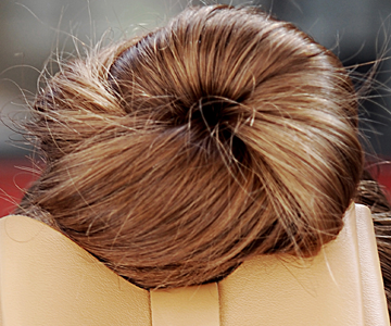 Woman with messy bun in blondette color