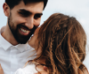 Woman with twilighted hair hugging a man