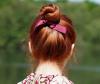 Woman with bun made using volumizing hair powder