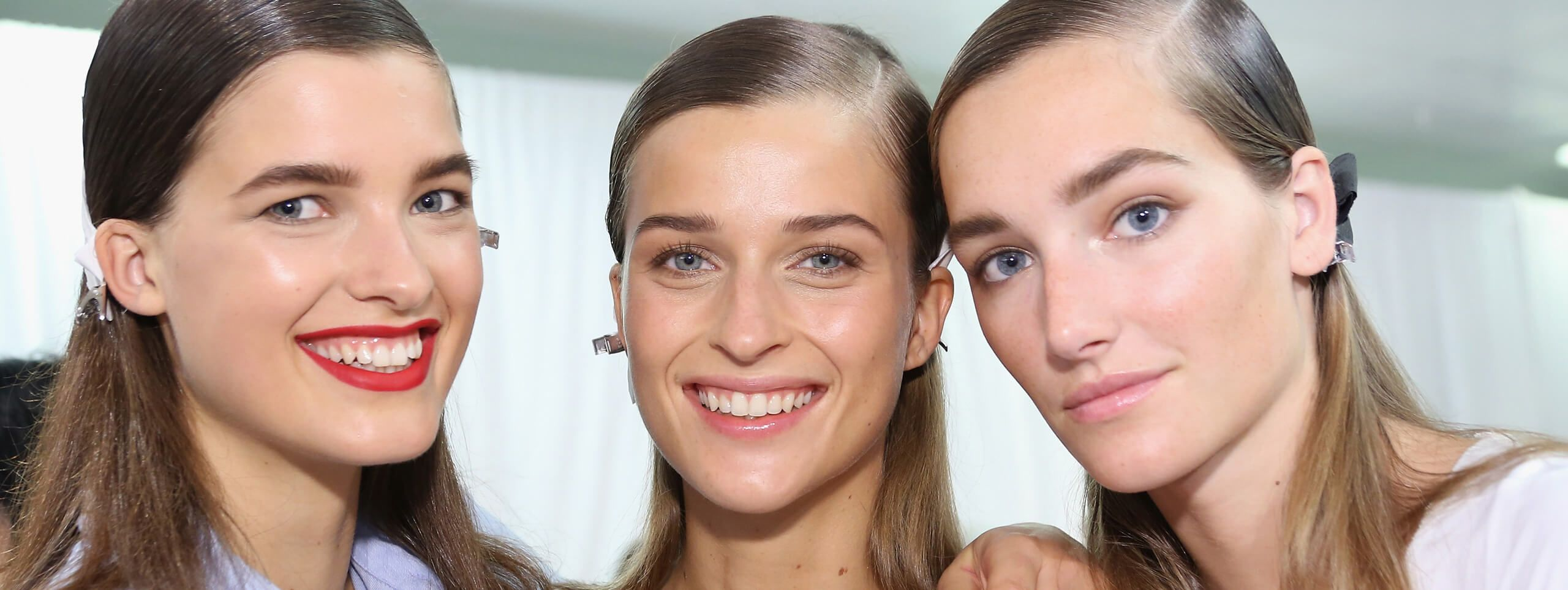 Female models rock wet-look hairstyles created with gel