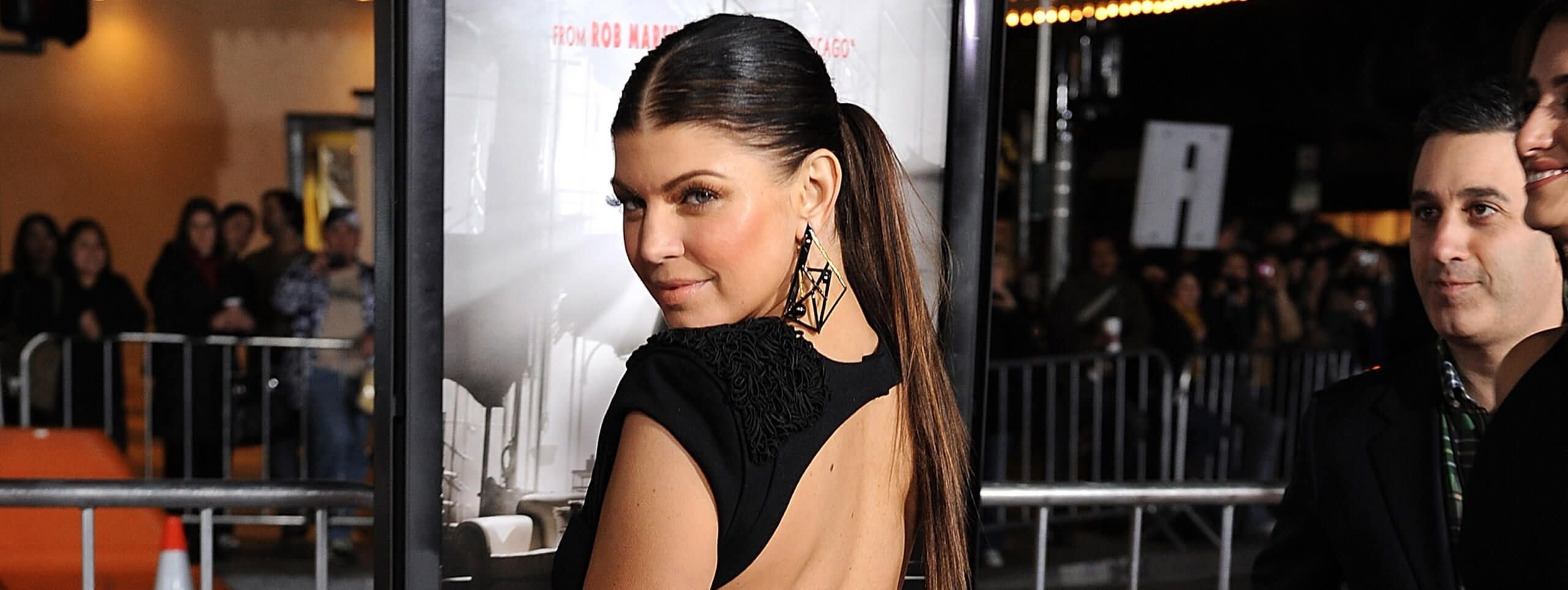 Fergie Black Eyed Peas wears long ponytail hairstyle
