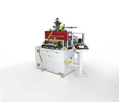 Photo of red and white PRECO flat bed automated die cutting machine