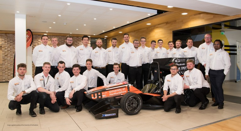 Image supplied curtesy of the University of Hertfordshire and shows the UH Racing 2019 Team and car