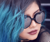 Girl with oil slick hair and heart sunglasses