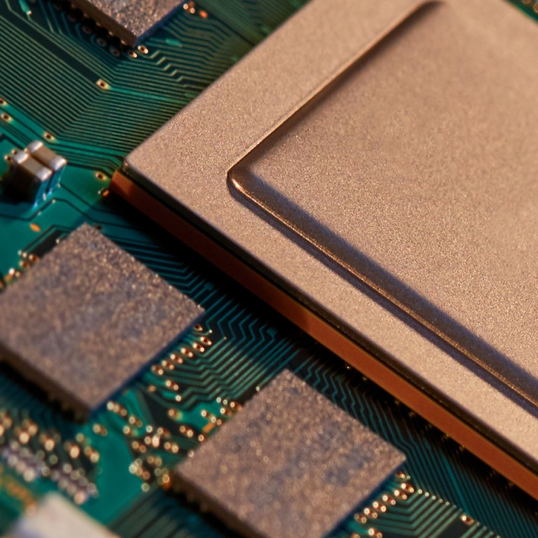 Close up of green gold electronic circuit board