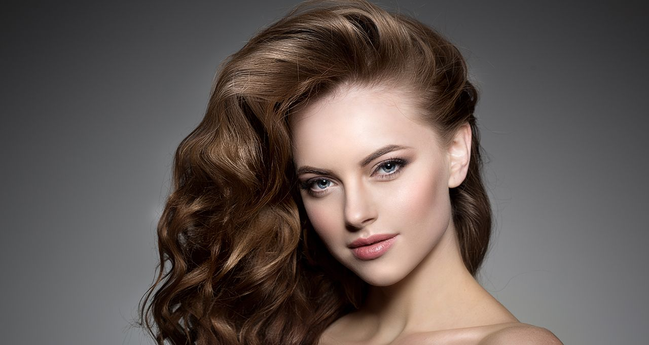 Brunette woman with bouncy curls