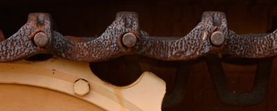 Extreme close up of rusted heavy duty construction machinery