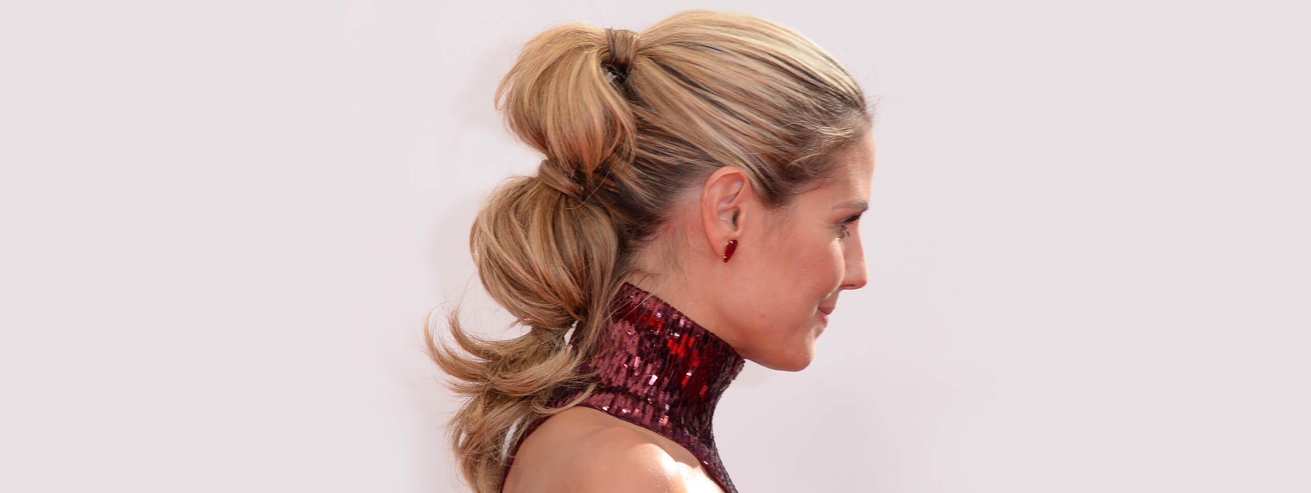 Heidi Klum wearing her hair in an elaborate pony tail hairstyle