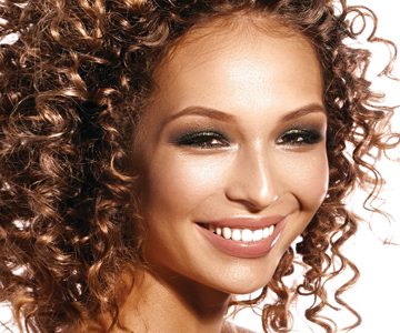 Woman with beautiful mid-length curly hairstyle