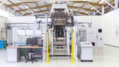 HP-RTM machine inside composite testing facility in Germany