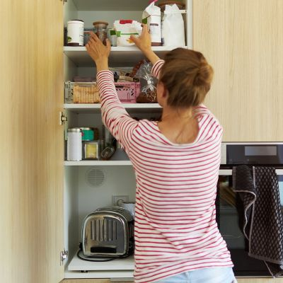 Cleaning kitchen cabinets and drawers