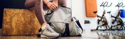 A person is looking into her sports bag