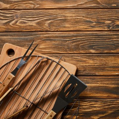 clean barbecue paraphernalia on wooden planks