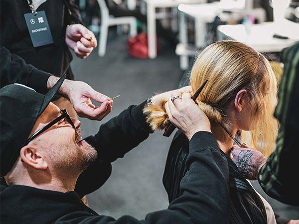 Armin Morbach styling a model at Mercedes-Benz Fashion Week