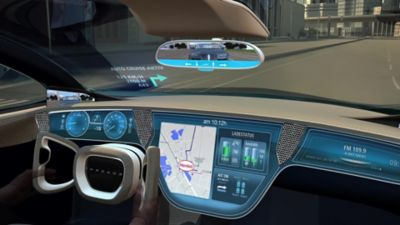 Innovative automotive cockpit with many types of displays while driving in daylight.