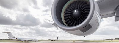 Cropped image of aircraft engine nacelle on runway with sky in background represents demanding aerospace propulsion environments gettyimages ID 597662503