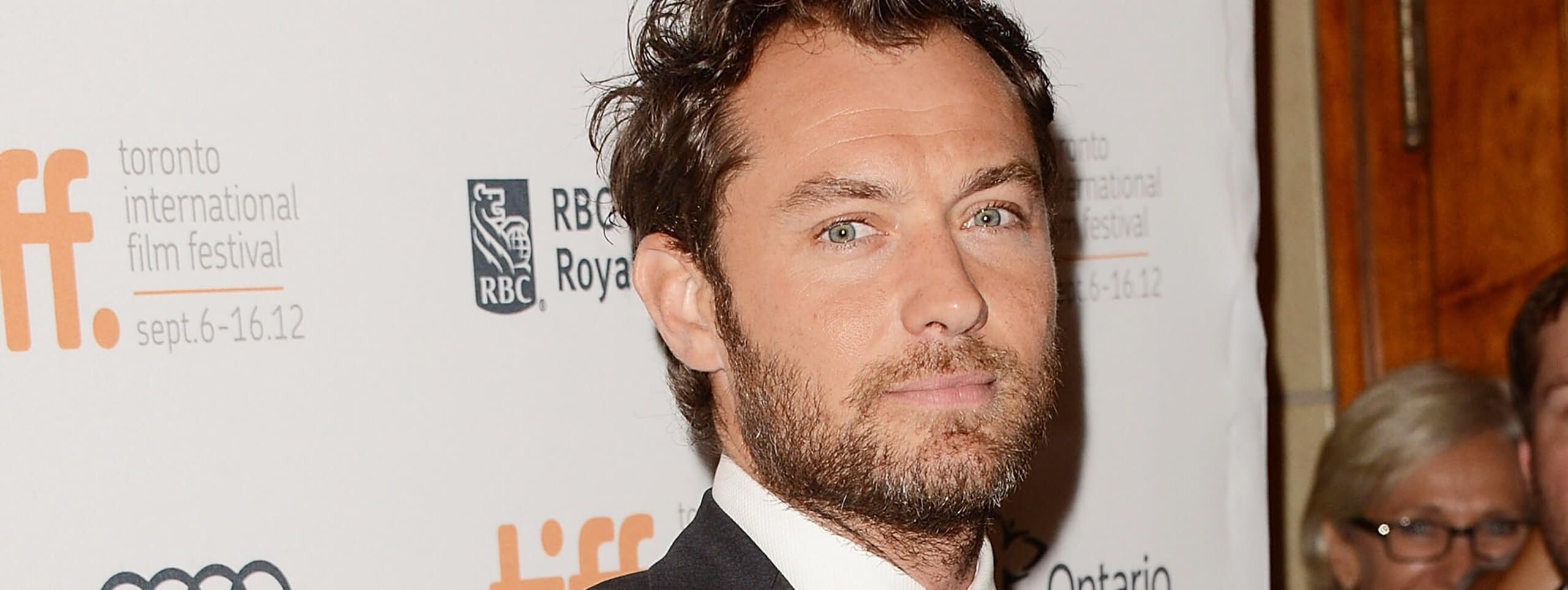 Jude Law with short hairstyle and stubble