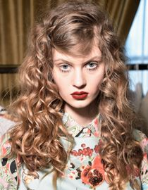 Woman with curls and fake bangs