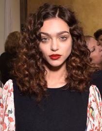 Brunette woman with corkscrew curls