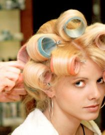 Blonde woman with velcro rollers in hair