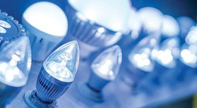 Blue lit lightbulbs on a board