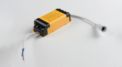 Photo of yelow and black LED panel driver used to rectify higher voltage, alternating current to low voltage, direct current shutterstock ID 1030507273