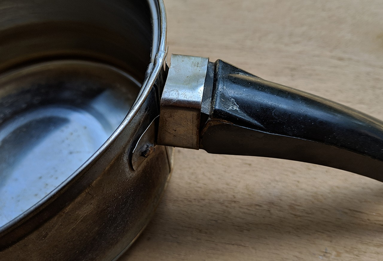 broken metal saucepan
