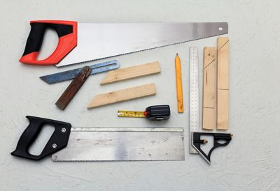 A pencil, molding pieces, and a scraper