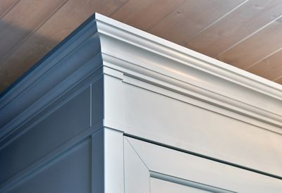 Crown moldings on top of an elegant cabinet
