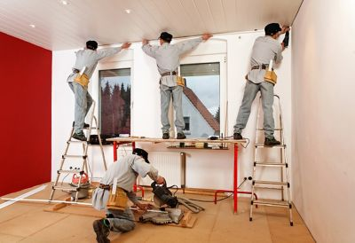 Men replace a crown molding
