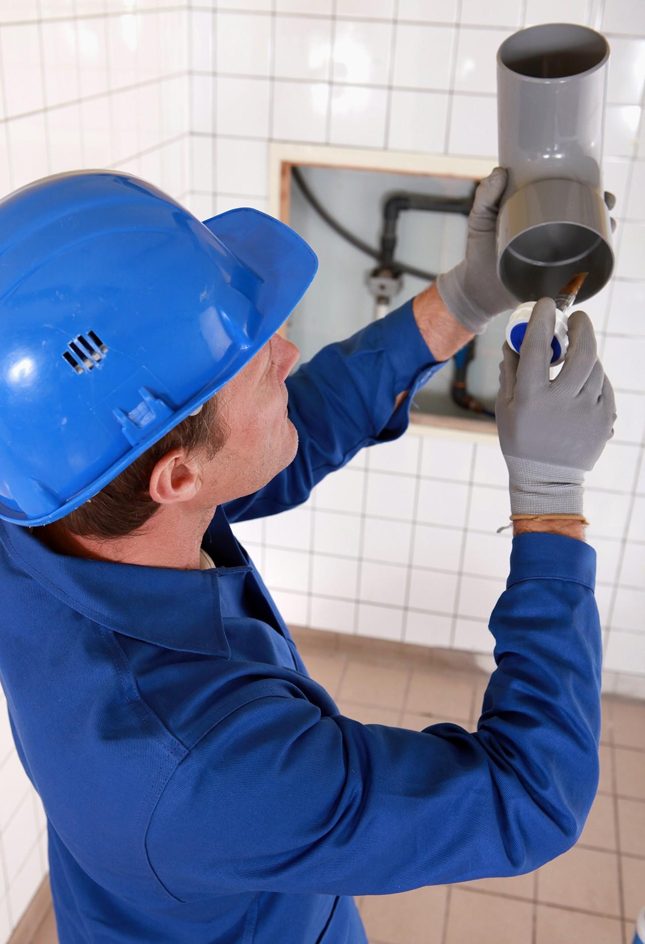 A man gluing metal