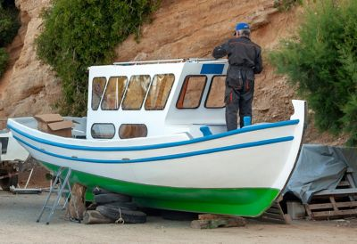 A man repairing a boat