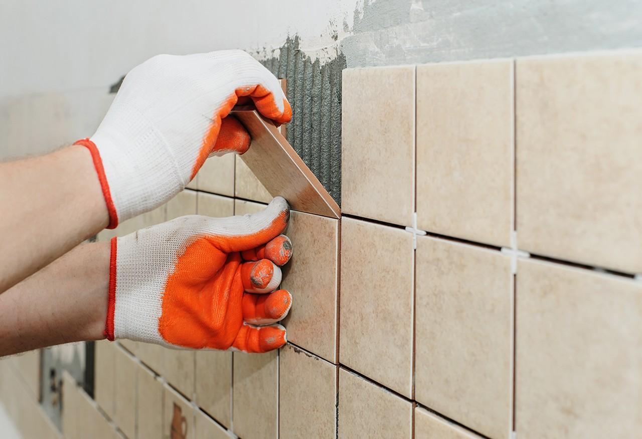 A man installs tiles