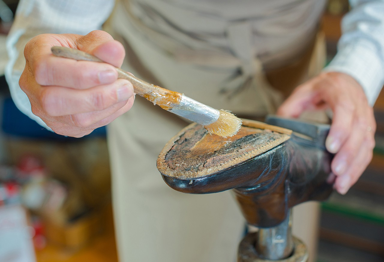 shoemaker gluing leather