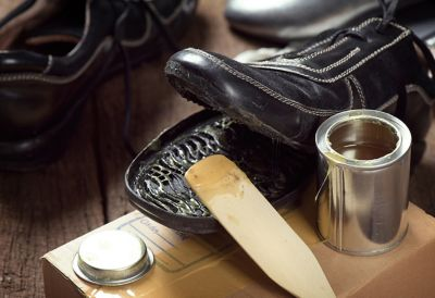 A well-used shoe sole being repaired with shoe glue