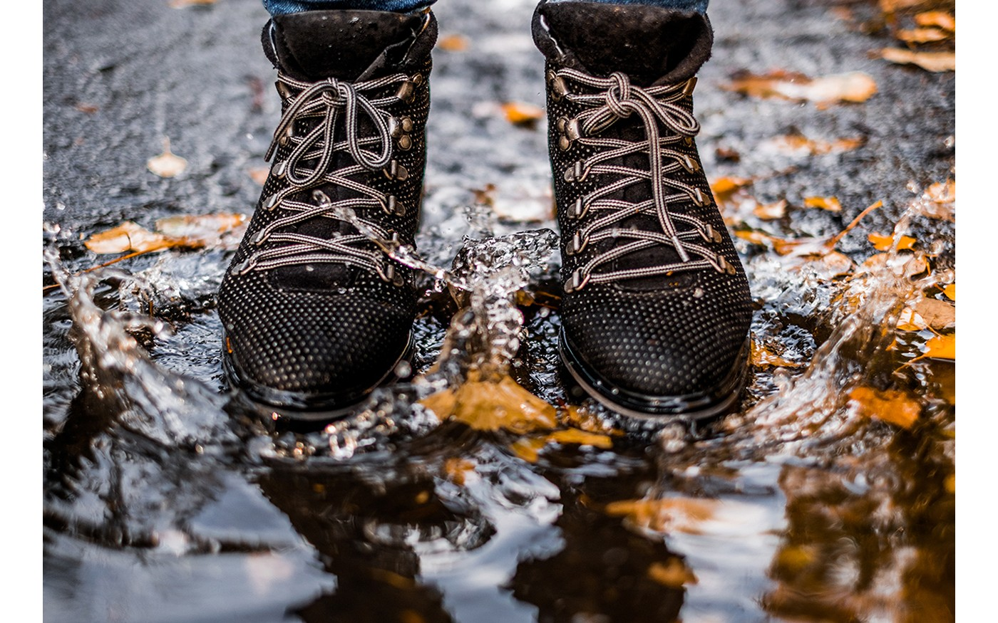 Person running through a puddle of water